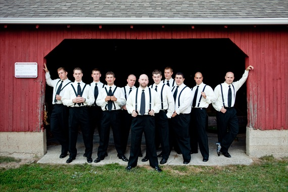 Vintage Fall Wedding - groomsmen in suspenders in front of red barn