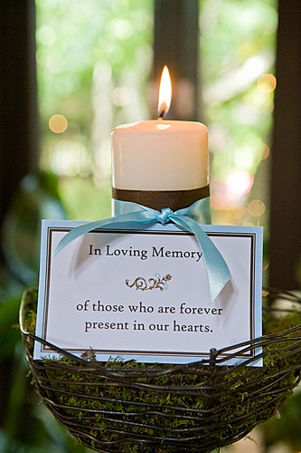 candle via How to Honor Loved Ones Who Have Passed at Wedding
