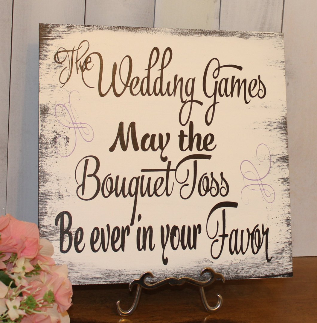 hunger games inspired bouquet toss sign