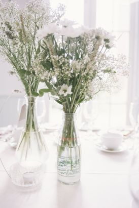 milk bottles filled with flowers