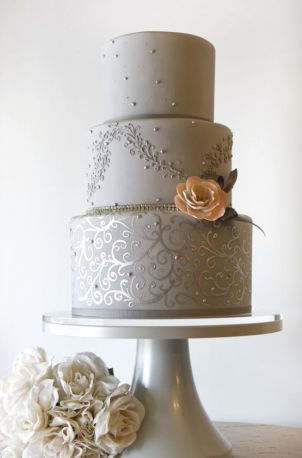grey wedding cake three tiered with pink flower accent