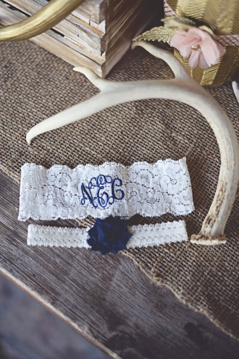 monogrammed wedding garter in blue stitching