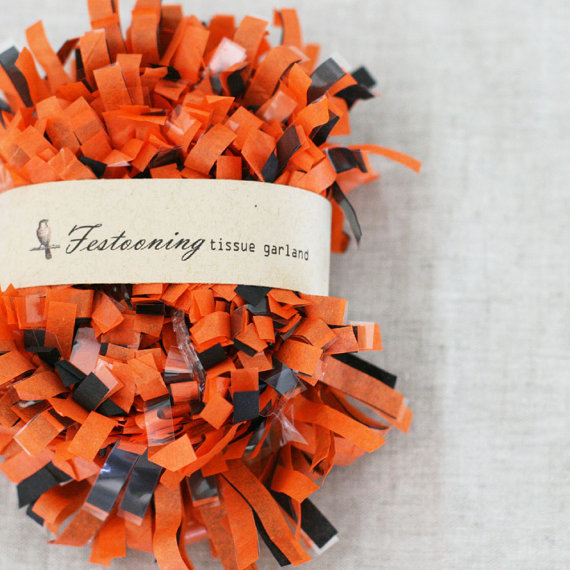 orange and black fringe decoration via 30 Amazing Halloween Wedding Ideas from EmmalineBride.com