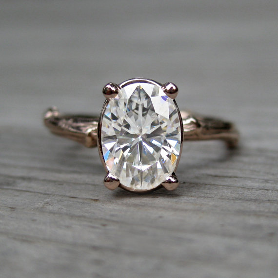 oval moissanite engagement ring (via 7 Alternative Engagement Ring Ideas)