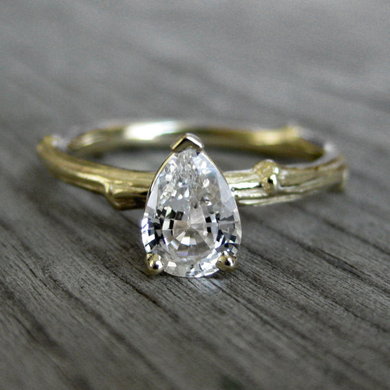pear shaped sapphire engagement ring with twig band