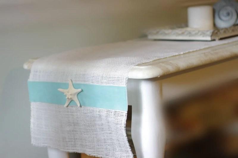 starfish table runner | via starfish wedding ideas: http://emmalinebride.com/beach/starfish-wedding-ideas/