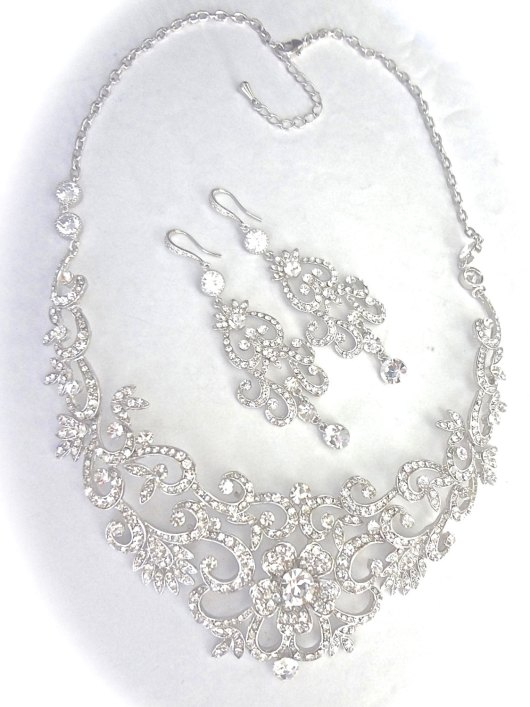 statement necklace | via Wedding Dress with Statement Necklace http://emmalinebride.com/bridal/wedding-dress-with-statement-necklace/