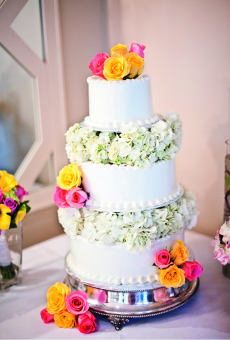 wedding cake with bright roses