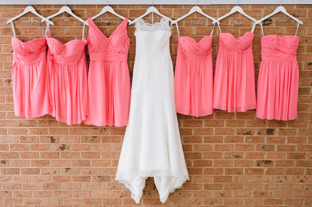 wedding-dress-with-personalized-hanger-next-to-bridesmaid-dresses-with-personalized-hangers