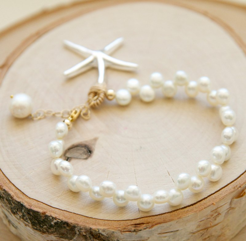 pearl starfish bracelet for the beach bride | via starfish wedding ideas: http://emmalinebride.com/beach/starfish-wedding-ideas/