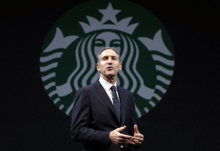 Starbucks CEO Howard Schultz speaks at the company's annual shareholders meeting, Wednesday, March 20, 2013, in Seattle, Wash. (AP Photo/Ted S. Warren)