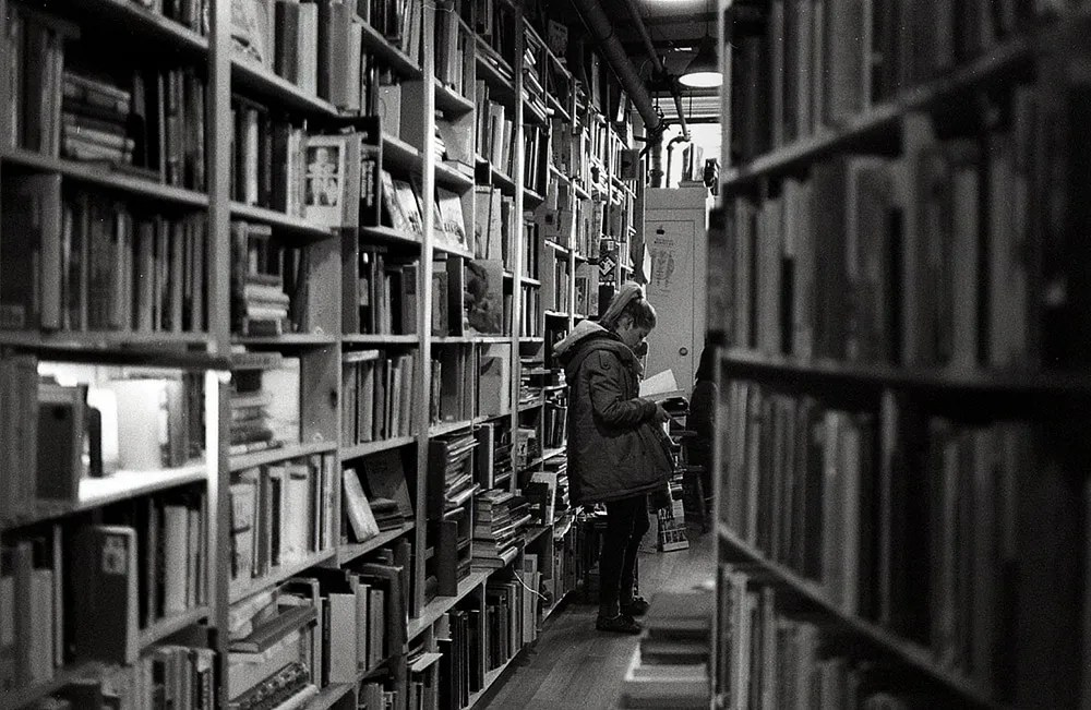 Vancouver, Leica M6, Kodak Double-X (5222) - There's a second-hand bookstore in Vancouver called, the Paper Hound. I have found many gems in this tiny store... mostly antique children's books. But the owner's real passion is on cheesy sci-fi pocket books.