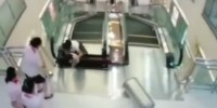 Shocking Video Mother Swallowed By Escalator In China