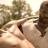 Benjamin Jones (Jeremiah Trotter) carries Lewis (John Wooten).