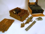 Relic, battle-field found Enigma next to a well preserved, working Enigma machine.