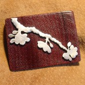 Set into a purpleheart plaque