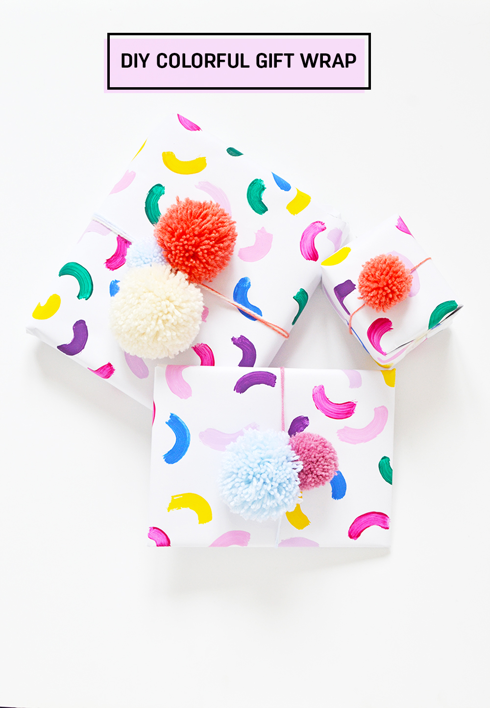 Make an easy colorful gift wrap with pom pom topper