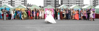 bride groom and guests posting outside the beach huts in hove. Colour and black and white
