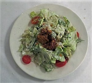 Salad Maison with romaine lettuce, grape tomatoes, crumbled bleu cheese and pecans