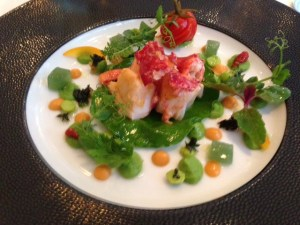 Lobster vinaigrette, pea purée, ginger, mint and orange peel, sweet and sour tomatoes, and wild herbs