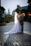 No umbrella needed.  Brave the cold and the rain to get the great shot.  Northstar at Tahoe Village wedding in the rain.
