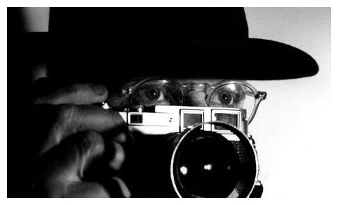 The master, Henri Cartier-Bresson with his camera. Click to read more.