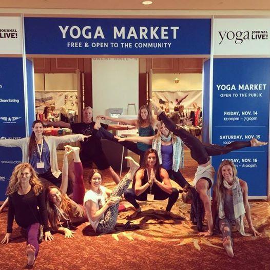 Yoga Pagoda Crew Asana Style in front of Market