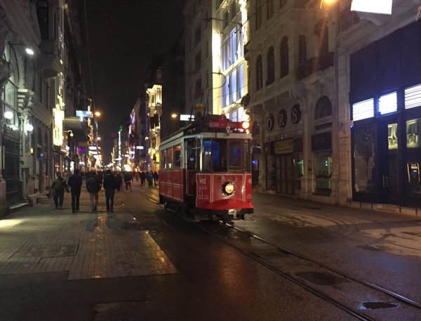 """Istiklal open again. Classic tram back on track, rides through a ghost-town Taksim of closed shops & broken windows. https://twitter.com/TomasThoren/status/711249735542284288"