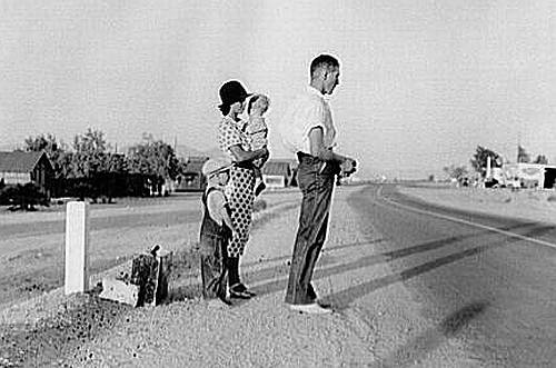 Great Depression: Oklahoma farm family on highway between Blythe and Indio. Forced by the drought of 1936 to abandon their farm, they set out with their children to drive to California. Picking cotton in Arizona for a day or two at a time gave them enough for food and gas to continue. On this day, they were within a day's travel of their destination, Bakersfield, California. Their car had broken down en route and was abandoned. Photo by Dorothea Lange. Courtesy Library of Congress, Prints & Photographs Division, FSA-OWI Collection LC-USF34- 009680-C