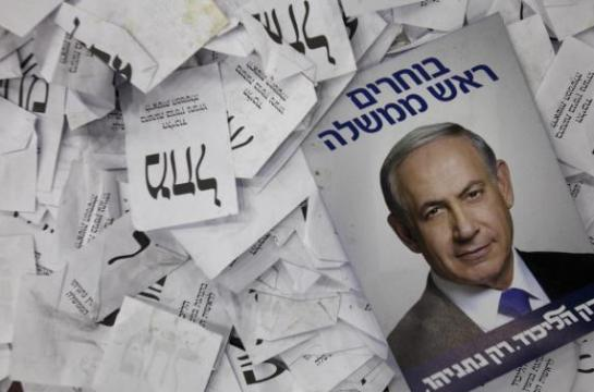 "This Wednesday, March 18, 2015 photo, shows Israeli Prime Minister Benjamin Netanyahu election campaign poster lying among ballot papers at his party's election headquarters in Tel Aviv. Israel's visceral election campaign has exposed a rift that many here thought had long subsided _ the deep-seated schism between Jews of European and Middle Eastern descent. Mizrahi, or Middle Eastern, Jews heavily backed Prime Minister Benjamin Netanyahu's Likud Party, while Ashkenazi, or European, Jews mostly identified with the opposition Zionist Union. The Hebrew on the photo reads: ""Choosing Prime Minister, only Likud only Netanyahu"".  (AP Photo/Dan Balilty)"