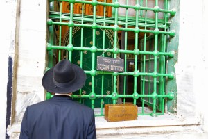 This worshiper has a view of Abraham's burial site from the Jewish side of the Tomb of the Patriarchs. (photo credit: Rick Steves/Rick Steves' Europe)