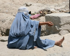 Afghan woman begging