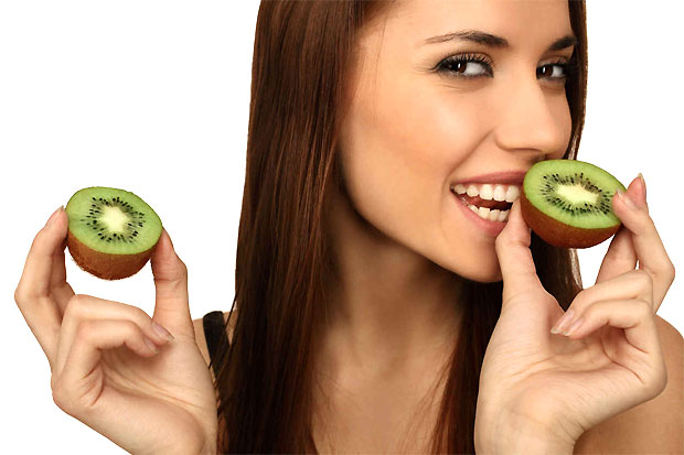 girl eating kiwi