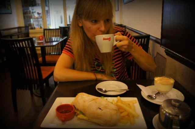 A girl is eating in Macau