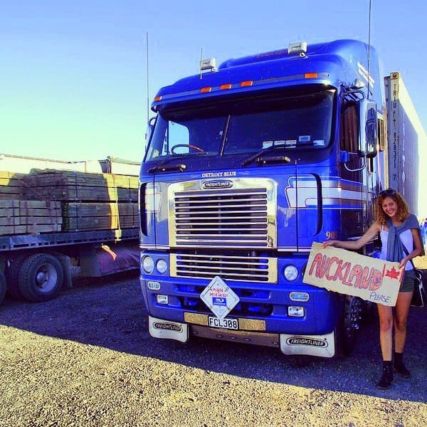 A girl hitchhiking in New Zealand