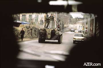 Soviet APC in Baku during the week of January 20, 1990. Reza secretly took this photo through a car windshield because it was too dangerous to openly photograph the Black January events. Photo: Reza.
