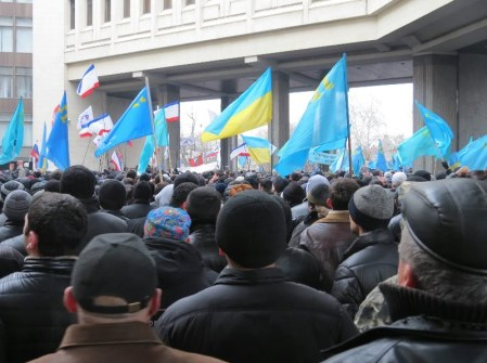 Crimean Tatar rally outside the Crimean Parliament in Simferopol which is being seized by unmarked armed men