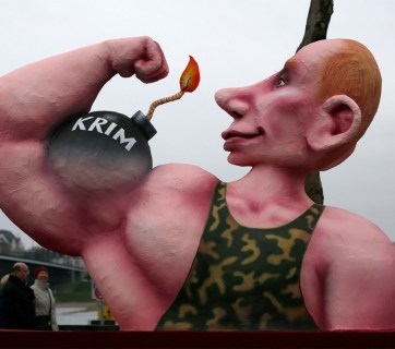 A float in Duesseldorf features a a papier-mache caricature of Russian President Vladimir Putin flexing his muscle with the word 'Crimea' written on it. Reuters