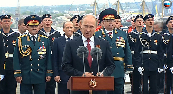Putin speaking in occupied Sevastopol on the anniversary of the WW2 Victory Day to celebrate Russia's annexation of the Crimean peninsula from Ukraine conducted by his military and special forces two months earlier. May 9, 2014 (Image: kremlin.ru)