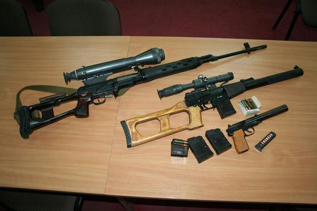 "Russian ""SVD"" sniper rifle, ""Vintorez"" Russian special forces' sniper rifle, and ""6P9"" special forces' silenced pistol seized from the members of the arrested terrorist and spy group operating in Kharkiv, which was recruited and controlled by Russian military intelligence. (Image: SBU)"