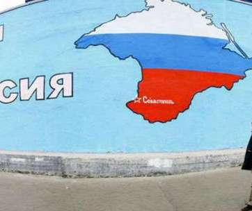 Graffiti with Crimea painted in colors of the Russian flag