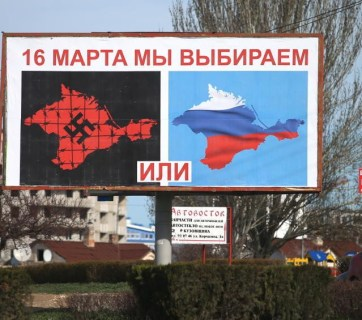 "Moscow propaganda poster plastered all over Crimea before the illegal ""referendum"" of March 16, 2014."