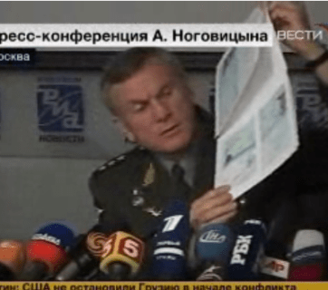 Russian military spokesman Anatoliy Nogovitsyn holding what he claims to be a xerox of a US citizen's passport found in Georgia
