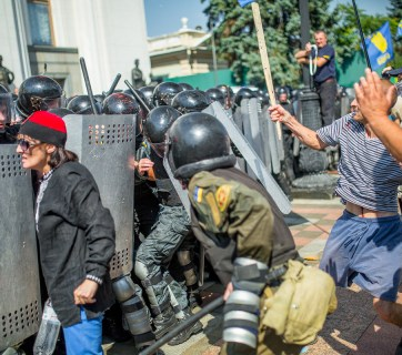 Protesters clash with riot police outside Ukrainian Parliament after decentralization vote. Photo: Vladislav Sodel.