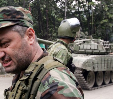 """President"" of the breakaway South Ossetia region, Eduard Kokoity stands near Russian tanks and troops in the South Ossetian town of Dzhava on August 9, 2008. (Dmitry Kostyukov/AFP)"