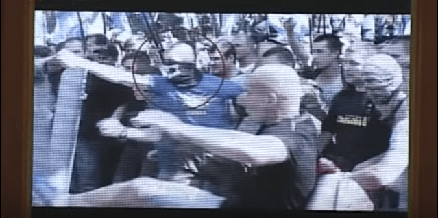 Video of protester pepper spraying a riot policeman