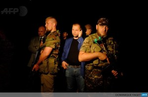 "Alexander Borodai and other leaders of, self-proclaimed ""Donetsk People's Republic"" at the MH17 Crash Site, July 17, 2014"