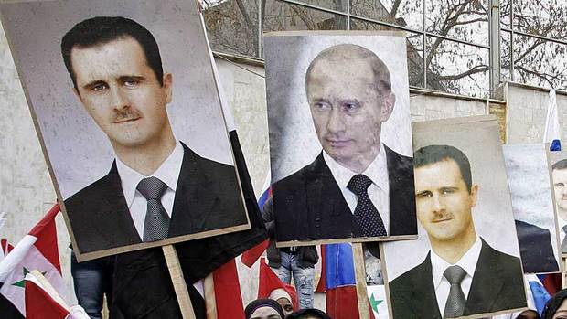 Assad and Putin posters in Syria