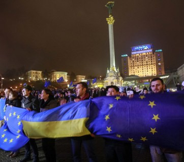 Euromaidan protesters hold EU and Ukrainian flags in the center of Kyiv in winter of 2013-2014