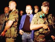 "Alexandr Borodai, self-proclaimed ""Prime Minister"" of the ""DNR"", surrounded by Russian-backed militants"